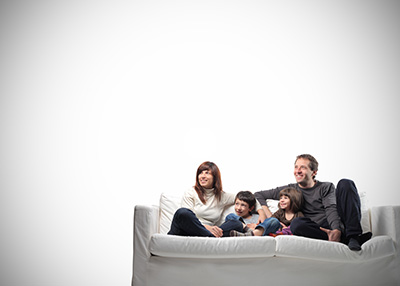 fam-on-couch-white